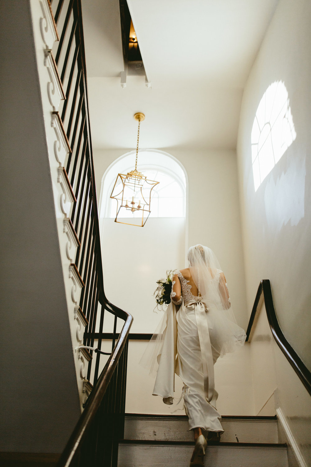 lace backed wedding dress, lace wedding dress, bride on staircase, unique wedding dress inspiration, cream wedding dress, low back wedding dress, groomsmen, bridal party photo inspiration, black tie bridal party, black tie groom, groomsmen in tux, groomsmen style ideas, Philadelphia wedding, destination wedding, Brooklyn wedding, Brooklyn elopement, Philadelphia elopement, Gadsden house Charleston South Carolina, southern wedding inspiration, unique wedding inspiration, wedding inspiration, destination wedding inspiration, wedding ideas, romantic wedding inspiration, classy wedding ideas
