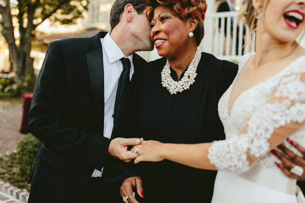wedding photo with officiant, wedding family photos ideas, mother of the groom, mother of the bride, bridal inspiration, courtyard wedding ceremony, backyard wedding ceremony, wedding ceremony inspiration, unique ceremony location, groomsmen, bridal party photo inspiration, black tie bridal party, black tie groom, groomsmen in tux, groomsmen style ideas, Philadelphia wedding, destination wedding, Brooklyn wedding, Brooklyn elopement, Philadelphia elopement, Gadsden house Charleston South Carolina, southern wedding inspiration, unique wedding inspiration, wedding inspiration, destination wedding inspiration, wedding ideas, romantic wedding inspiration, classy wedding ideas