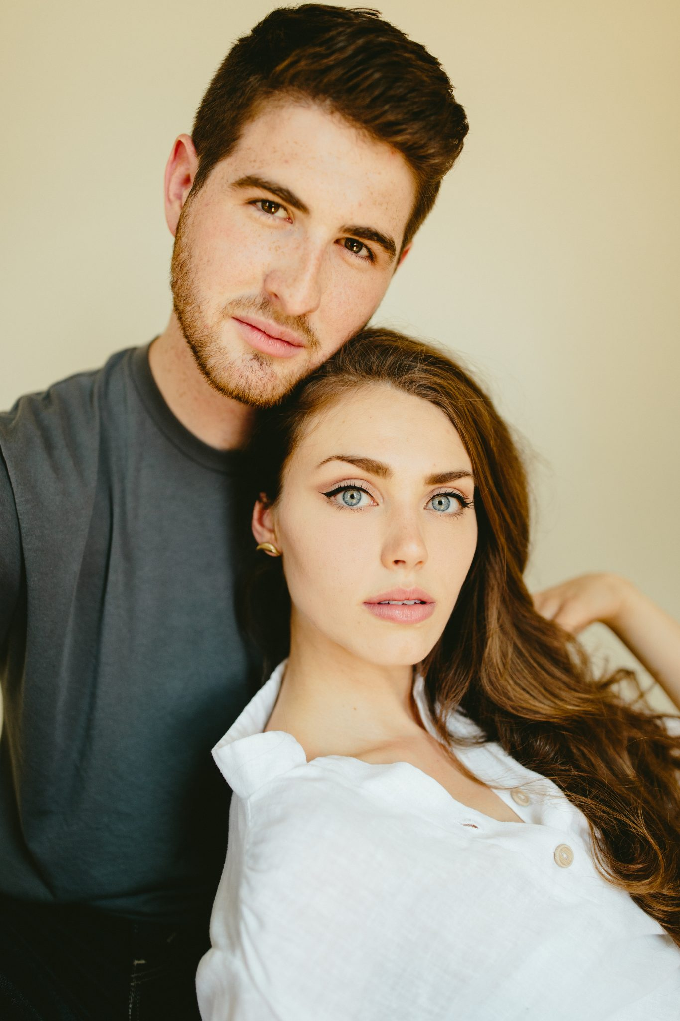 Engaged Lancaster couple modeling in studio
