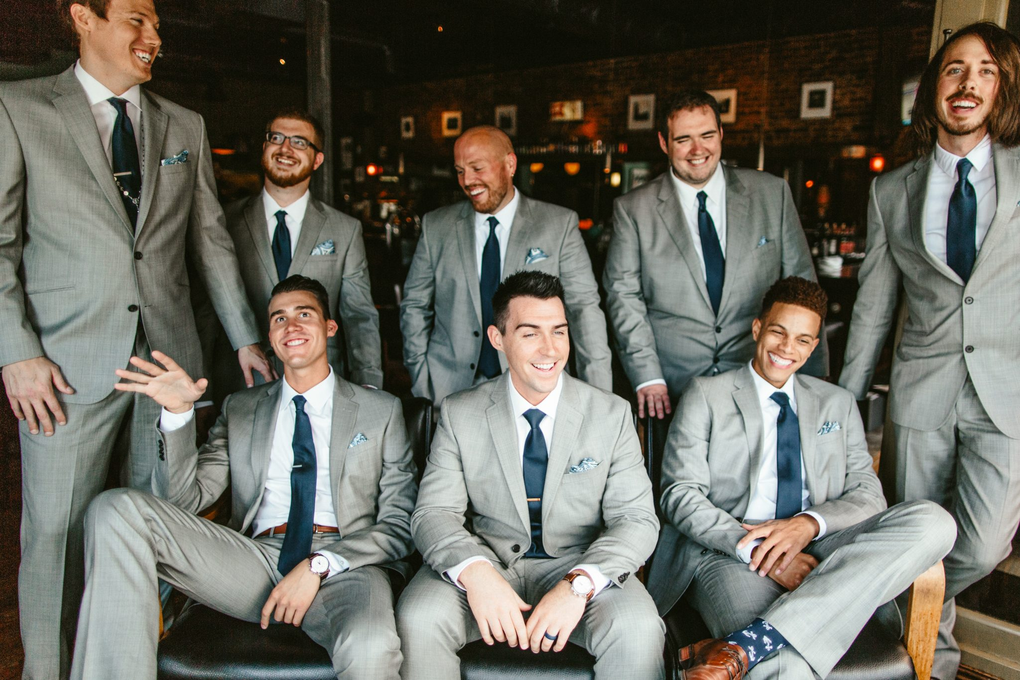 groomsmen style, groomsmen in grey suit, groomsmen with blue tie, groomsmen photos, bar groomsmen photos, bridal party photos at a bar, bar bridal party photos, unique wedding photo location, bar wedding inspiration, philadelphia documentary wedding photographer, Brooklyn wedding photography, Brooklyn wedding, Philadelphia wedding photographer, Philadelphia wedding, Brooklyn new york photographer, unique wedding inspiration, fun wedding photos, romantic wedding, destination wedding photographer, wedding photography inspiration, destination wedding inspiration, city wedding ideas