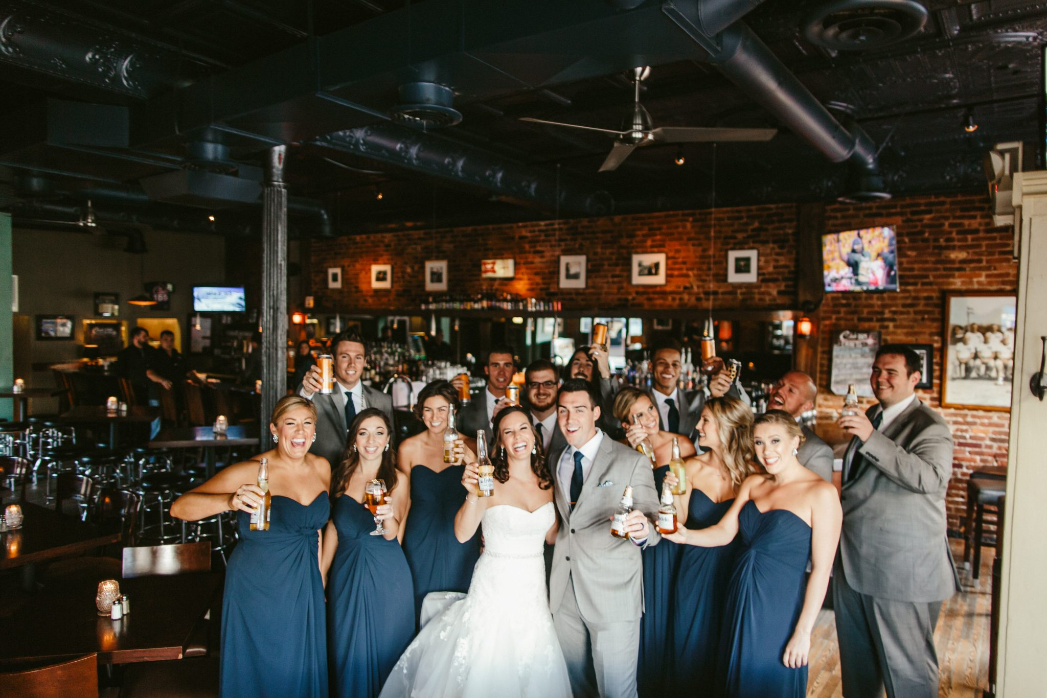 bar bridal party photos, indoor bridal party photos, unique bridal party photos, blue bridesmaid dresses, grey groomsmen suits, bridal party drinking photos, philadelphia documentary wedding photographer, Brooklyn wedding photography, Brooklyn wedding, Philadelphia wedding photographer, Philadelphia wedding, Brooklyn new york photographer, unique wedding inspiration, fun wedding photos, romantic wedding, destination wedding photographer, wedding photography inspiration, destination wedding inspiration, city wedding ideas
