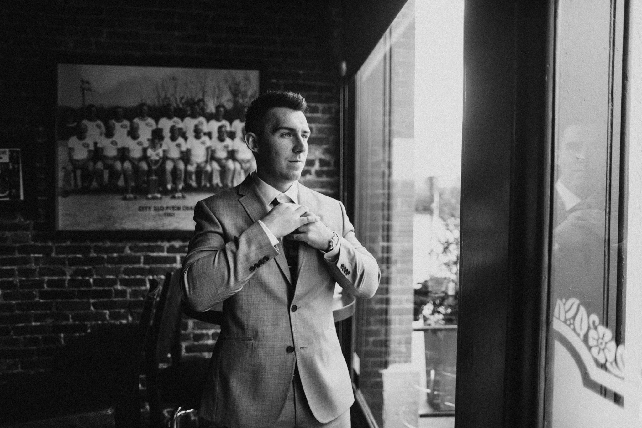 groom in bar, groomsmen attire indoor groom portraits, groom portraits in bar, groom in grey suit, groom style inspiration, philadelphia documentary wedding photographer, groom getting ready photos, urban groom, Brooklyn groom style, Brooklyn wedding photography, Brooklyn wedding, Philadelphia wedding photographer, Philadelphia wedding, Brooklyn new york photographer, unique wedding inspiration, fun wedding photos, romantic wedding, destination wedding photographer, wedding photography inspiration, destination wedding inspiration, city wedding ideas