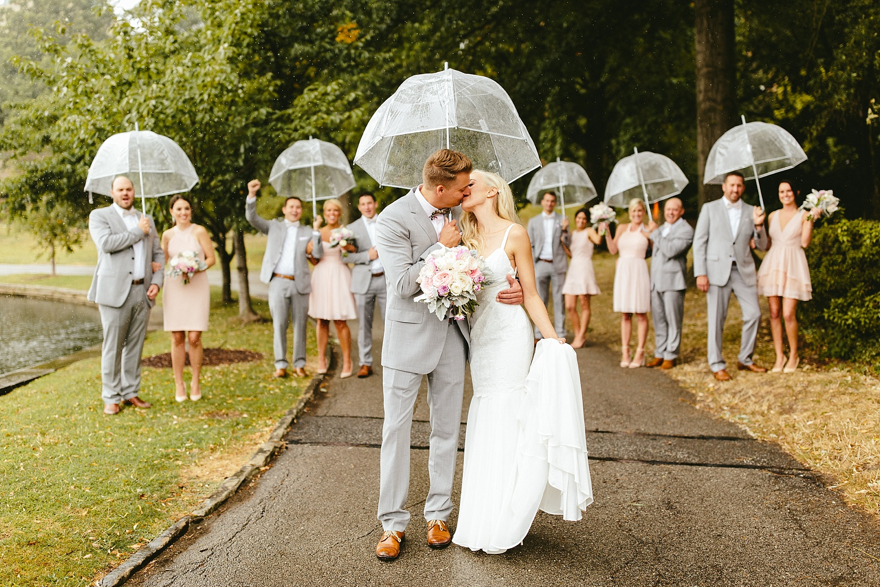 blush bridesmaid dresses, clear umbrellas for wedding, bridal party with clear umbrellas, knee length bridesmaids dresses, grey groomsmen suits, pastel wedding colors, pastel wedding theme, pastel bouquet, blush wedding flowers, unique bridal party photos, Brooklyn wedding photography, Brooklyn wedding, Philadelphia wedding photographer, Philadelphia wedding, Brooklyn new york photographer, unique wedding inspiration, fun wedding photos, romantic wedding, destination wedding photographer